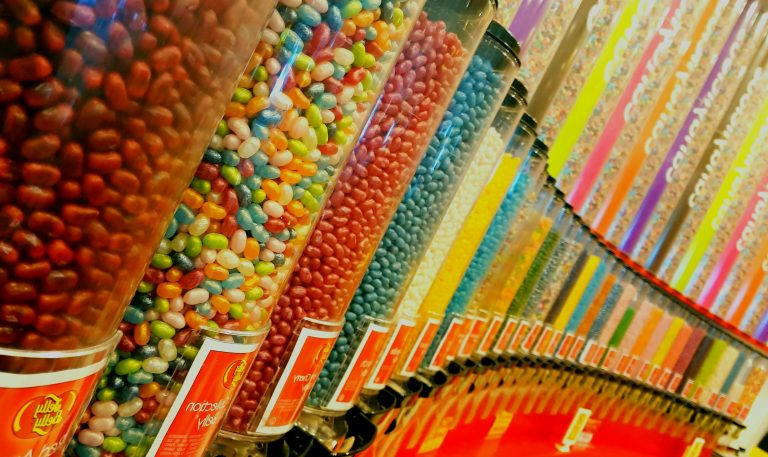 candy lining a wall in a shop