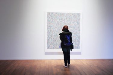 a girl looking at art