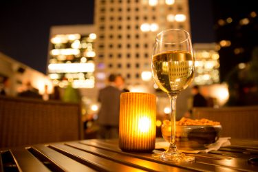 a glass of wine and the view from one of Chicago's best rooftop bars