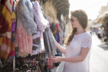 beautiful young woman shopping for vintage scarves at the Randolph Street Market Festival