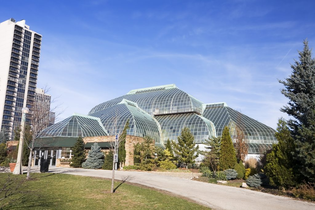 Lincoln Park Conservatory glass domed building with trees and walking path