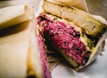 Closeup photo of Reuben sandwich with pastrami at a deli in Chicago