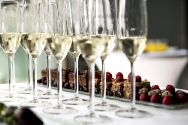 Table with samples of champagne wine and chocolate