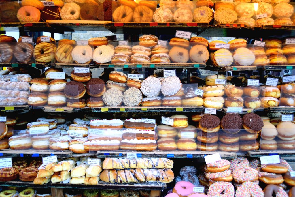 Shelves full of donuts at a donut shop