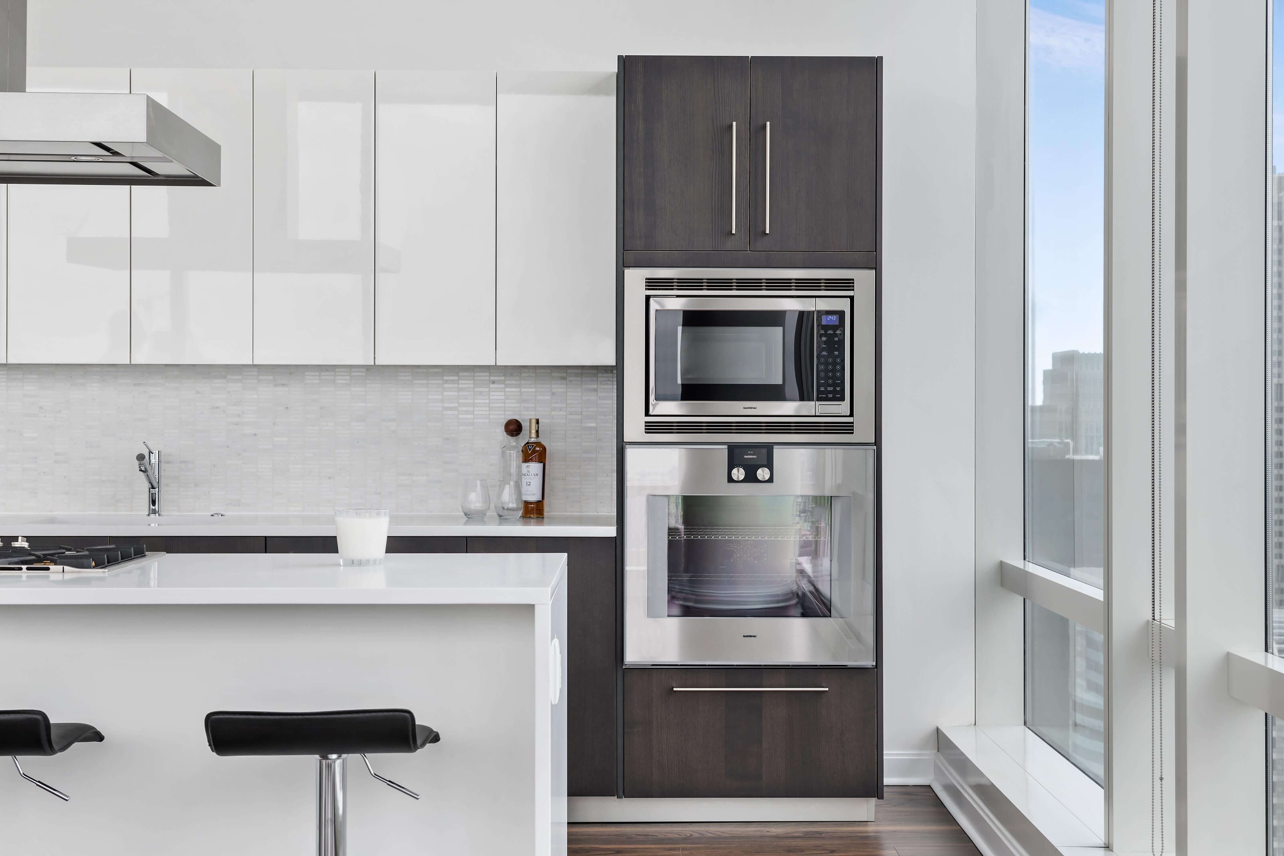 Be romanced by designer kitchens with duotone cabinetry, Gaggenau appliances and a wine cooler. banner